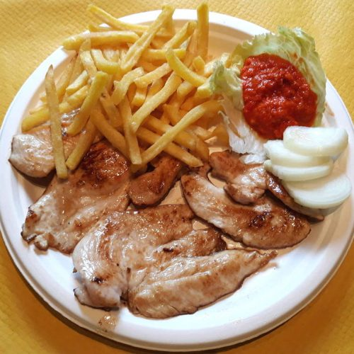Chicken fillet with french fries, onion and ajvar.